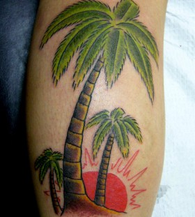 Coloured palm tree arm tattoo