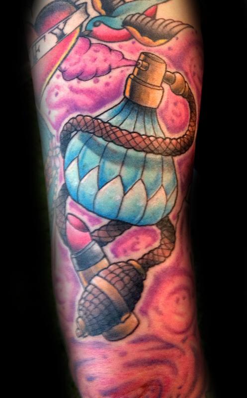 Coloured perfume bottle tattoo