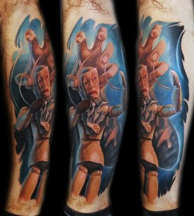 Coloured puppet master tattoo