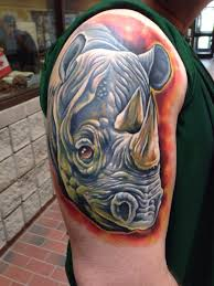 Coloured rhino arm tattoo