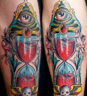 Coloured sand clock tattoo