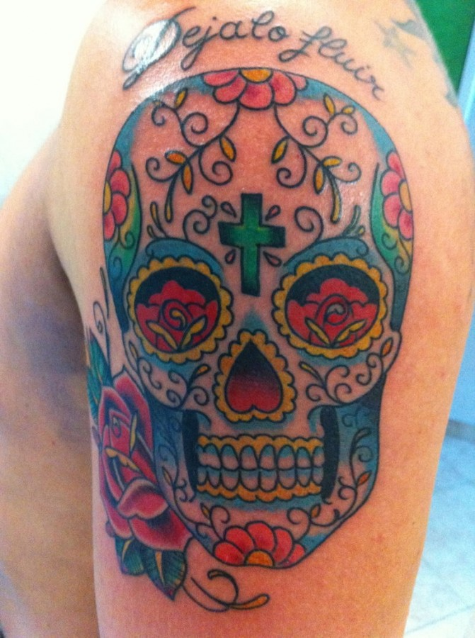 Coloured skull and roses tattoo