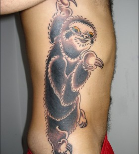 Coloured sloth side tattoo