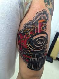 Coloured steaming train arm tattoo