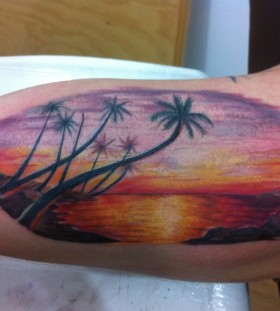 Coloured sunset arm tattoo