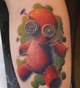 Coloured voodoo doll leg tattoo