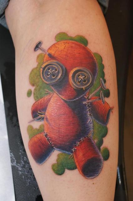 1f63f56df41cc Coloured voodoo doll leg tattoo -   TattooMagz › Tattoo Designs ...