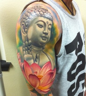 Colourful buddha and lotus flower tattoo