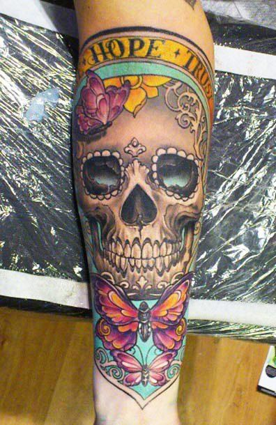 Colourful butterflies and skull tattoo by Ellen Westholm