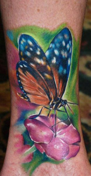 Colourful butterfly tattoo by Kyle Cotterman