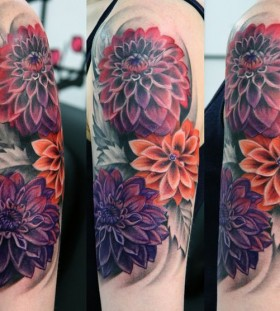Colourful dahlias arm tattoo