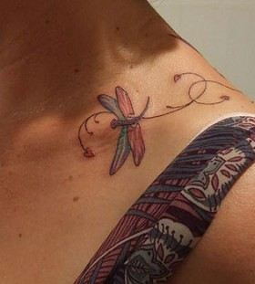 Colourful dragonfly collarbone tattoo