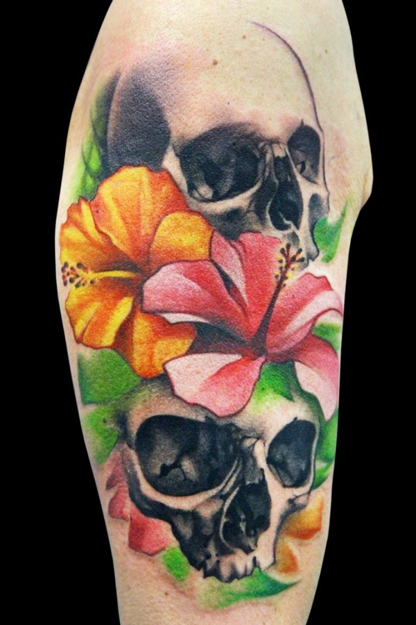Colourful flowers and skull tattoo