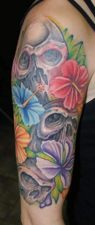 Colourful flowers and skulls tattoo