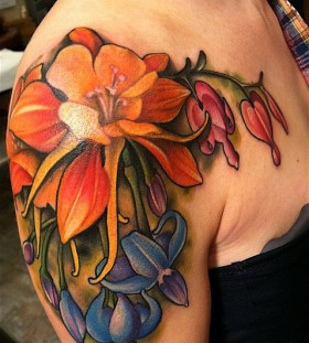 Colourful flowers shoulder tattoo by Amanda Leadman