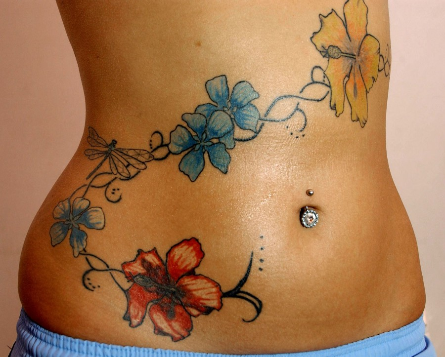 Colourful flowers stomach tattoo