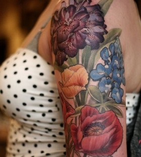 Colourful flowers tattoo by Alice Kendall