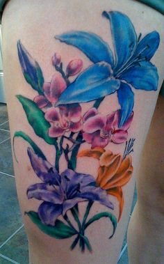 Colourful flowers tattoo by David Allen