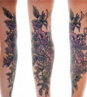 Colourful flowers tattoo by Rachel Hauer
