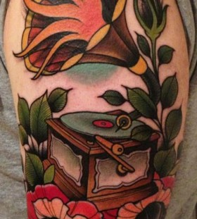 Colourful gramophone and flower tattoo