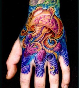 Colourful jellyfish hand tattoo