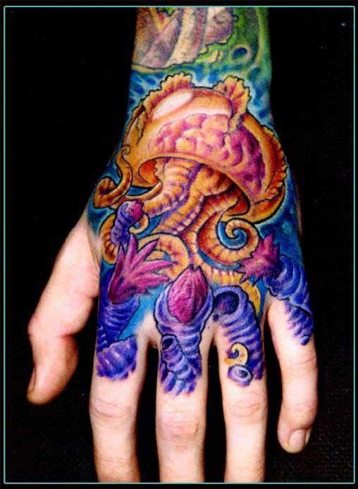 Colourful jellyfish hand tattoo