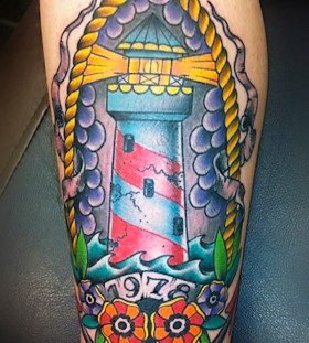 Colourful lighthouse arm tattoo