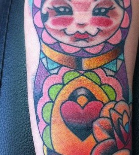 Colourful matryoshka arm tattoo