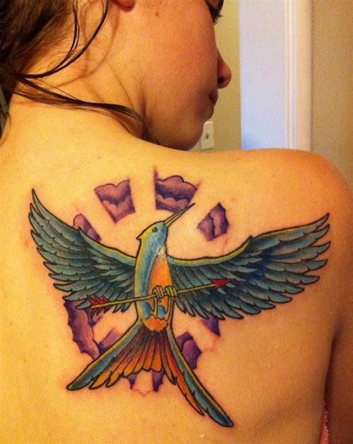 Colourful mockingjay back tattoo