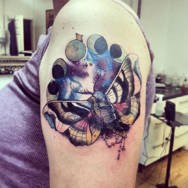 Colourful moth sleeve tattoo