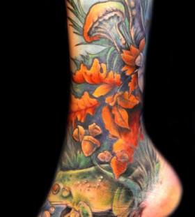 Colourful mushroom and frog leg tattoo