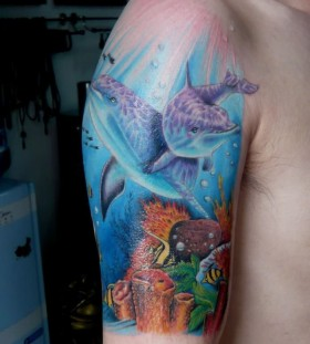 Colourful ocean and dolphins tattoo