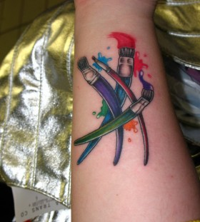 Colourful paint brushes tattoo
