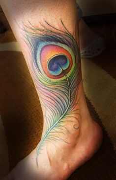 Colourful peacock feather tattoo by Jessica Brennan