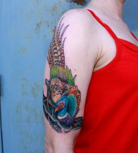 Colourful pheasant arm tattoo
