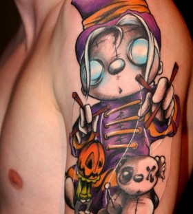 Colourful puppet master arm tattoo