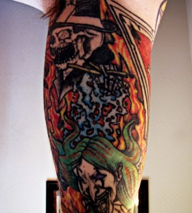 Colourful puppet master tattoo