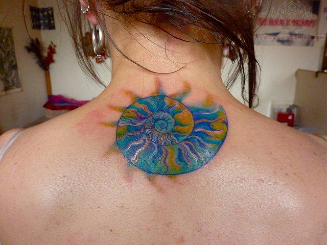 Colourful shell back tattoo