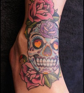 Colourful skull and rose ankle tattoo