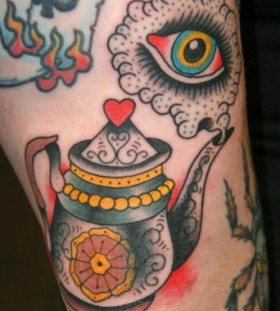 Colourful teapot and eye tattoo