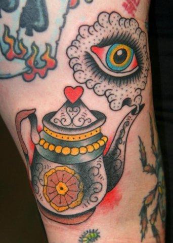 Colourful teapot and eye tattoo