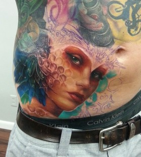 Colourful woman tattoo by Kyle Cotterman