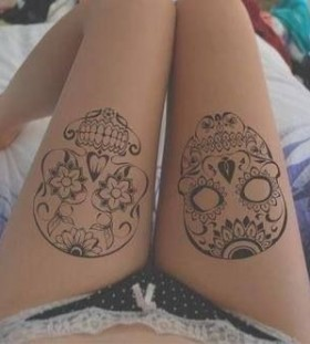 Cool Santa Muerte leg tattoos