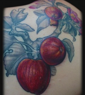 Cool apple branch tattoo