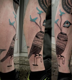 Cool birdcage tattoo by Expanded Eye