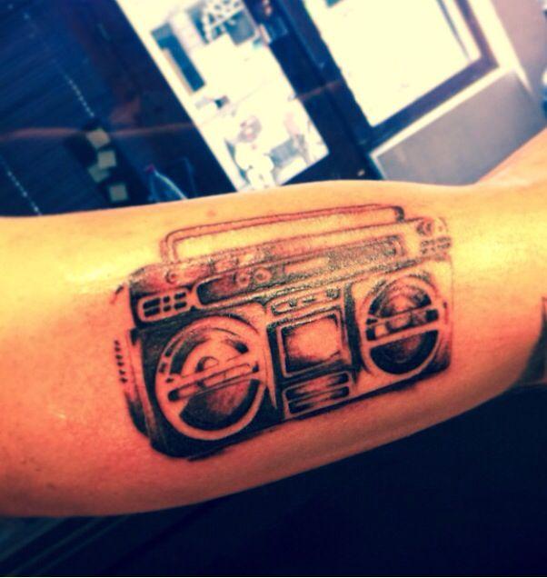 Cool boombox arm tattoo