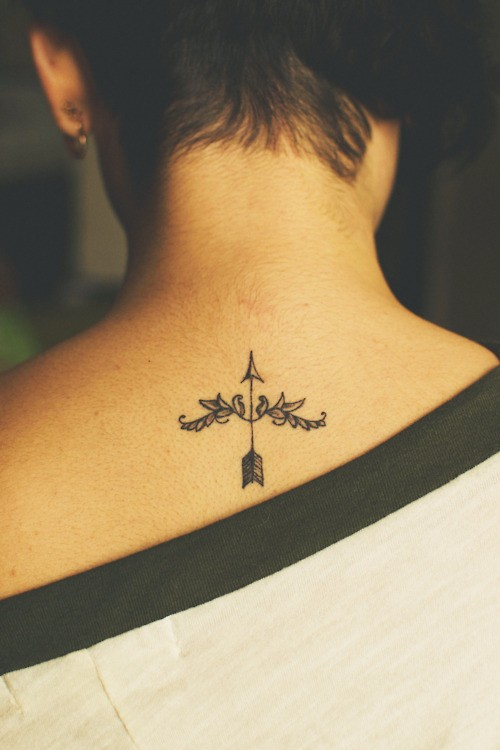 Cool bow and arrow back tattoo