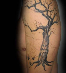 Cool dead tree arm tattoo