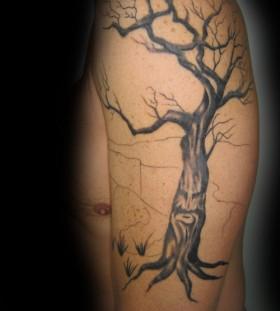 Cool dead tree arm tattoo