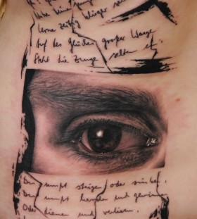 Cool eye and writing tattoo by Florian Karg